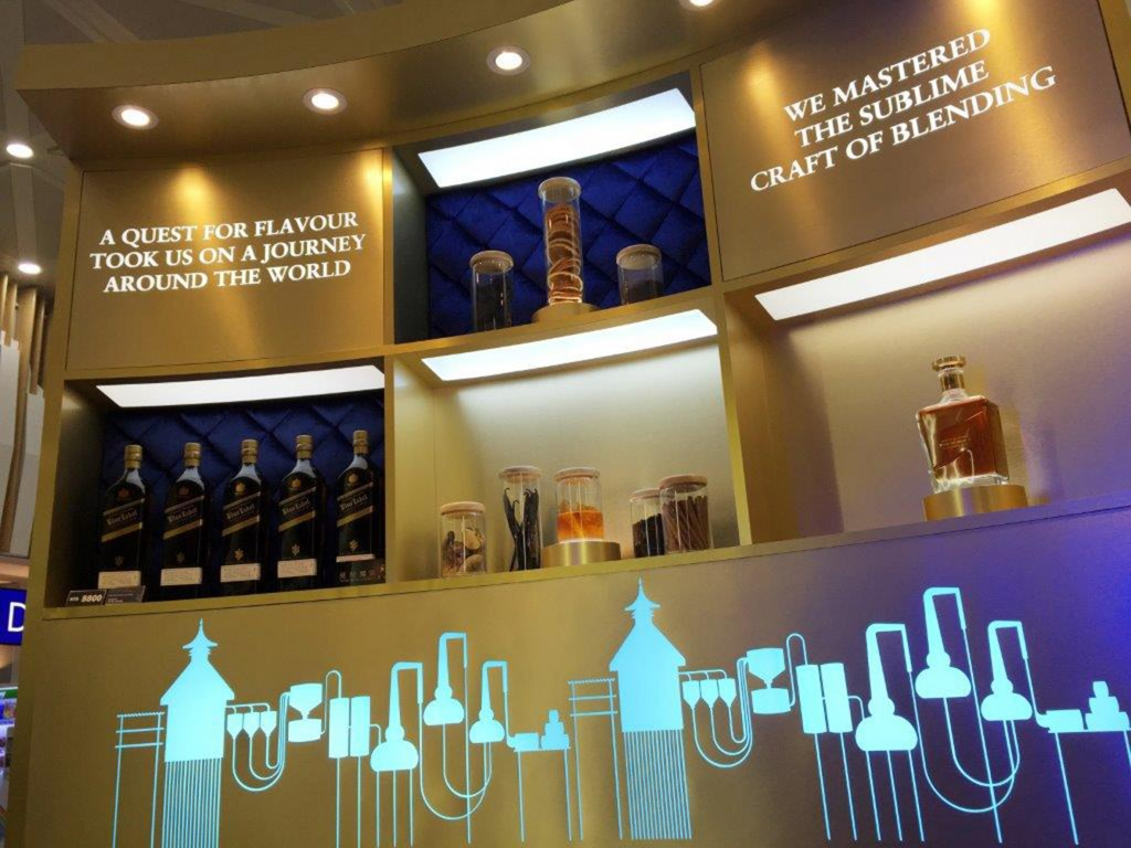 Luxury blends, including JOHNNIE WALKER BLUE LABEL, on display in the Boutique