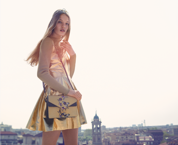 Coccinelle bags rooftop views of Milan in new campaign