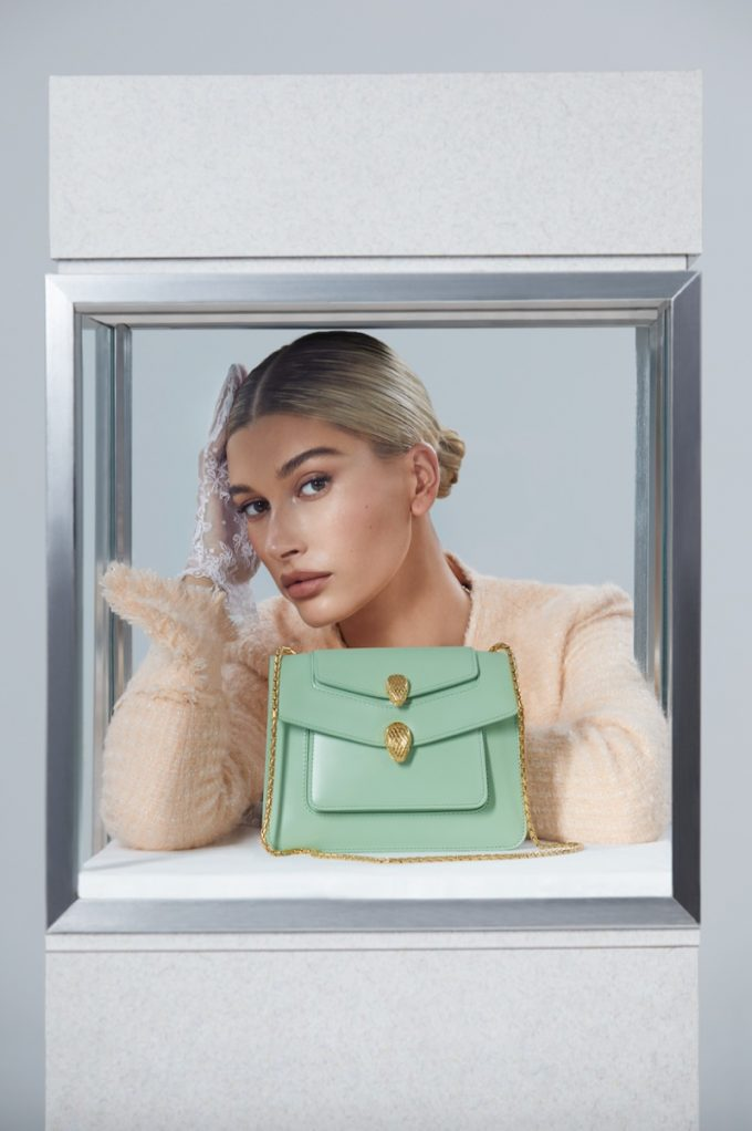 Hailey Bieber models the Bulgari x Alexander Wang handbag collection